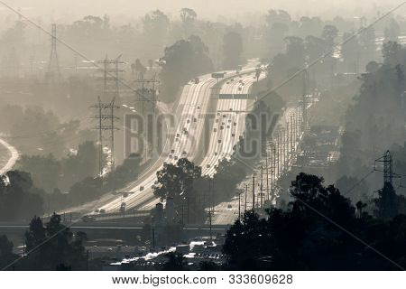 Hazy smoggy view of the 5 freeway near Riverside Drive, Griffith Park and the Los Angeles River in Southern California.