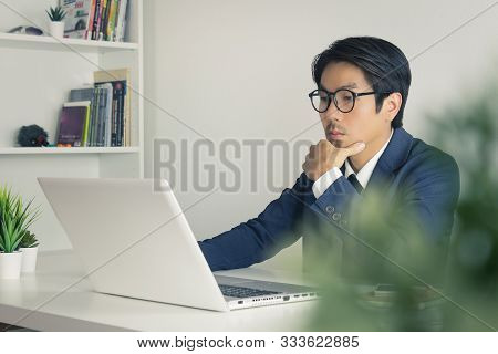 Asian Financial Advisor Or Asian Consulting Businessman Analyze Financial Information In Front Of La