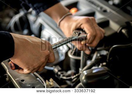 People Are Repair A Car Use A Wrench And A Screwdriver To Work.safe And Confident In Driving. Concep