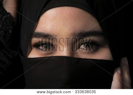 Close Up. A Muslim Women Have Beautiful Eyes Looking With Sharp Eyes And Has A Black Cover To Repres