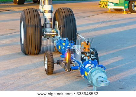 Tug Carrier For An Airplane, Trailer Front Landing Gear Pushback Aerodrome Tractor, Close Up View