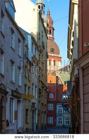 Riga, Latvia - October 28, 2019: Picturesque View Of Medieval Street With Riga Cathedral In Riga, La