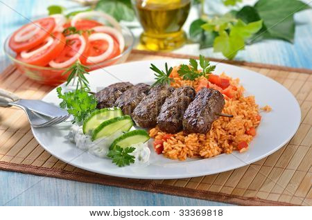 Grilled Greek meat balls with tzatziki and paprika rice poster