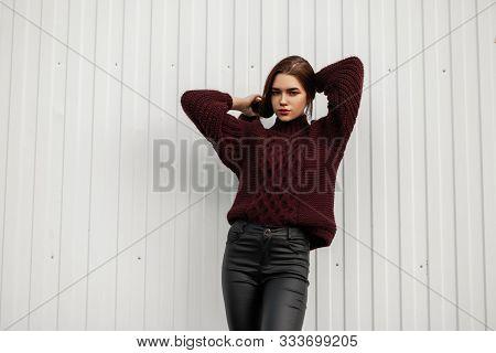 Pretty European Young Woman Straightens Hair. Beautiful Fashionable Girl Fashion Model Posing In Sty