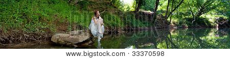 Panorama Of A Sad Bride Sitting On A Rock