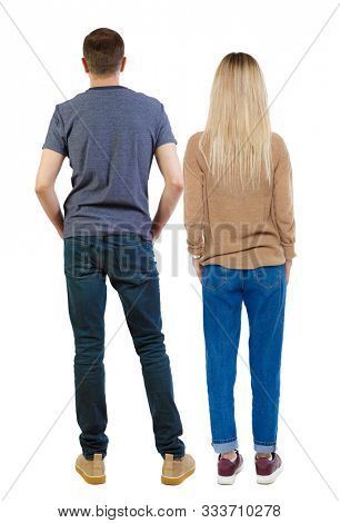 Back view of young embracing couple (man and woman) hug and look into the distance.  Rear view people collection.  backside view of person.  Isolated over white background. People stand with their han