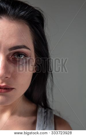 Woman In Fear Of Domestic Abuse And Violence, Concept Of Female Rights. Caucasian Brunette Woman On