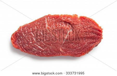 Raw Beef Piece With Spices Isolated On A White Background. Top View.