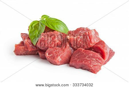 Raw Beef Pieces Isolated On A White Background.