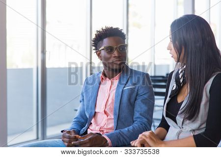 Colleagues Discussing Seminar. Two Young Business Man And Woman In Casual Sitting In Training Room A