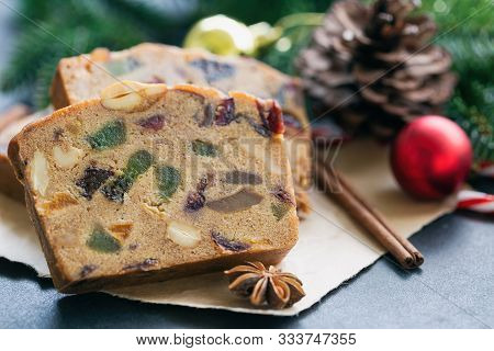 Sweet Christmas Fruit Cake Slices On Brown Paper Put On Black Granite Table In Side View Copy Space