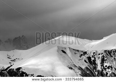 Sunlight Mountains With Snow Cornice And Trace From Avalanche Before Blizzard. Caucasus Mountains. S