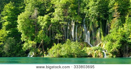 green wild forest, beautiful waterfall and turqoise river