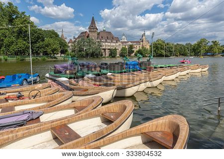 Budapest Vajdahunyad Castle Viewed From Its Lakeside And Jetty With Rowing Boats For Renting