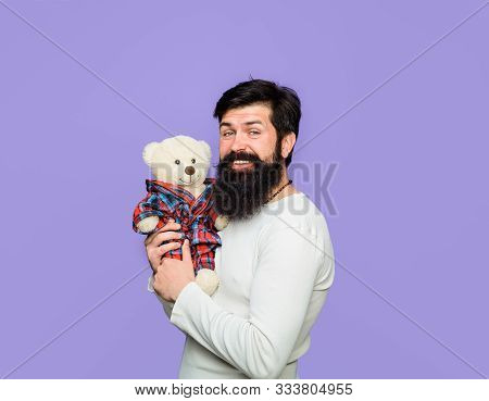 Happy Bearded Man With Plush Toy. Present For Birthday. Bearded Man Hugging Teddy Bear. Teddy Bear.