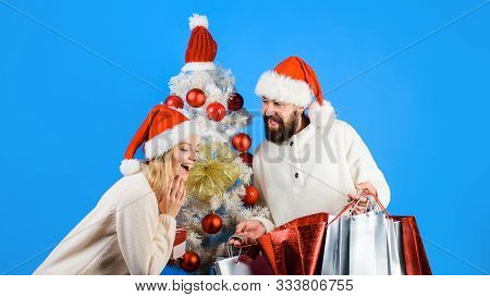 Shopping, Sale, Gifts, Christmastime Concept. Christmas And New Year Shopping. Happy Couple Shopping