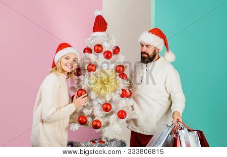 Shopping, Sale, Gifts, Christmastime Concept. Happy Couple Shopping For Christmas In Wintertime. Chr