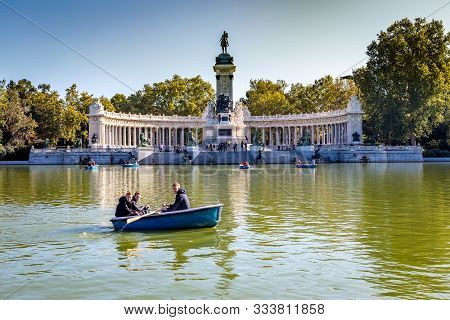 Madrid, Spain - October 21, 2019: Artifical Lake And Monument To Alfonso Xii In The Buen Retiro Park