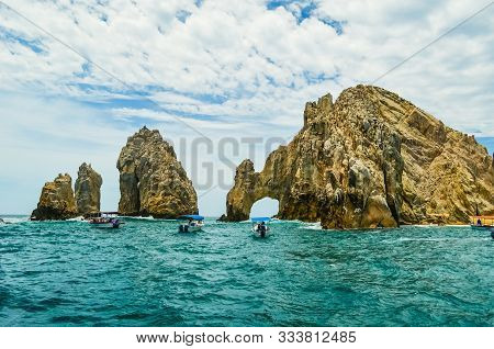 Tourists Visiting By Boat The Arch And Land's End At Sunset, Cabo San Lucas, Baja California, Mexico