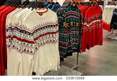 Moscow, Russia, November 2019: Bright Sweaters In White, Red. Green With A Christmas Pattern-gingerb
