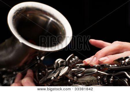 Girl plaing on saxophone