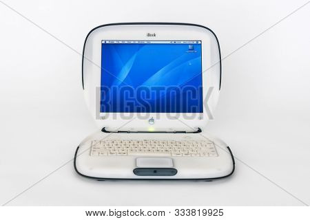 Los Angeles, California, USA - November 6, 2019:  Illustrative editorial photo of old working Apple clamshell style iBook laptop computer which was manufactured in the year 2000.