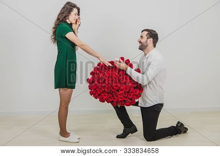 Tears Of Happiness Concept. Gorgeous Girl Crying When Boyfriend Kneeling In Front Of Her With Ring A