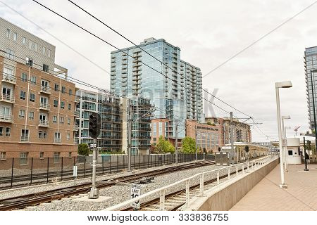 Train Tracks Near Union Station, Under The Millennium Bridge In The Riverfront Park Neighborhood Of