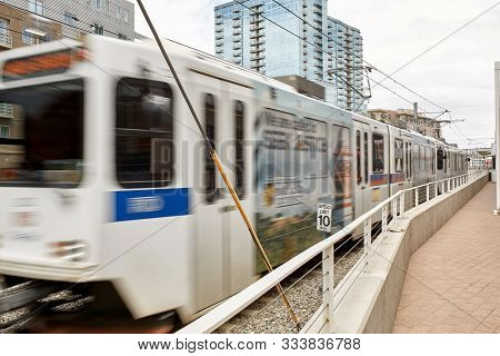 Denver, Colorado - May 19th, 2019: Light Rail Train In Motion Near Union Station And The Millennium