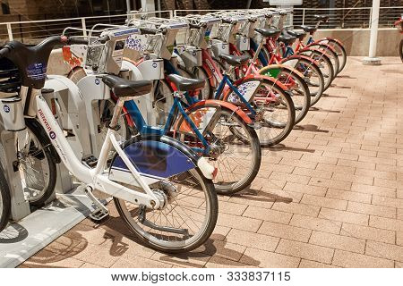 Denver, Colorado - May 19th, 2019: A Row Of Rental Bikes On Display At The Millennium Bridge In The