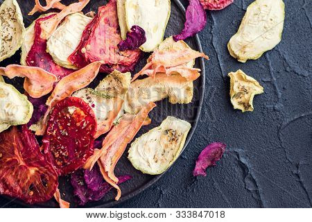 Healthy Homemade Vegetable Chips From Beetroot, Tomatoes, Carrot And Zucchini On Black Background. O
