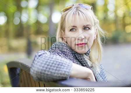 Forty Year Old Woman In The Park On The Street. Portrait Of Middle Age Man