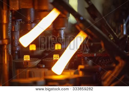 Glassworks. Glass Industry. Making Glass Bottles. Burning Blank Glass Bottle In The Machine