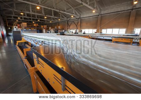 Blurry Glass Bottles On A Conveyor Belt.glassworks. Glass Industry.