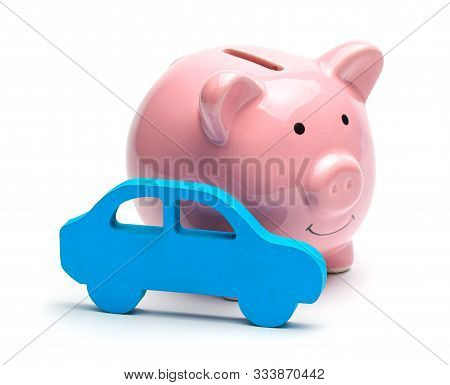 Pink Piggy Bank And Blue Car Isolated On White Background. Concept Of Saving Money On Buying A Car O
