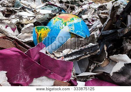 Broken Terrestrial Globe In The Garbage On The Landfill.