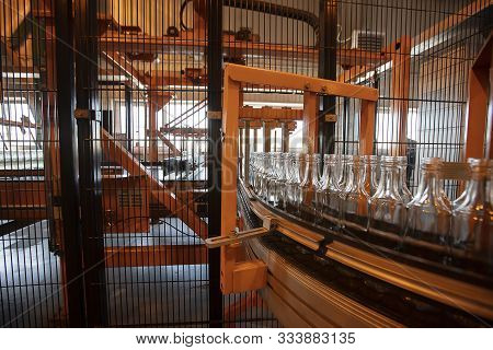 Glassworks. Glass Industry. Glass Bottle Packaging Line.