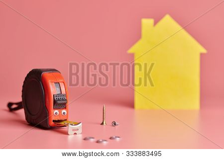 House Renovation Funny Concept. Metal Tape Measure And Other Repair Items. Home Repair And Redecorat