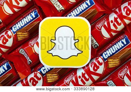 Snapchat Paper Logo On Many Kit Kat Chocolate Covered Wafer Bars In Red Wrapping. Advertising Chocol