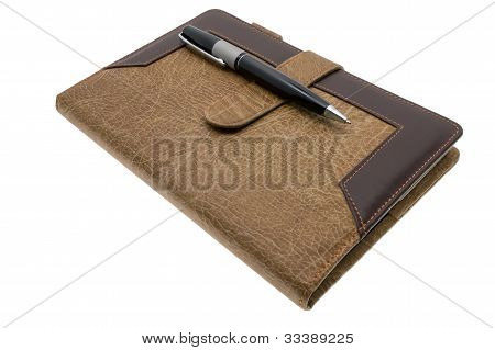 Brown notebook and pen