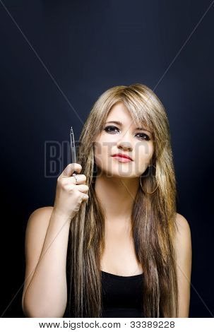 Business Woman Pointing To Advertising Copy Space
