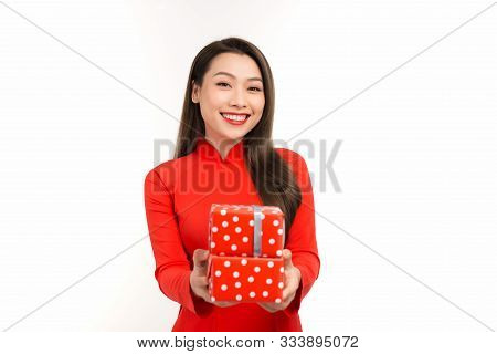 Woman In Vietnamese Traditional Dress Holding A Gift Box For A Tet Holiday