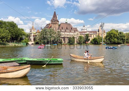 Budapest, Hungary - Juli 10, 2019: Budapest Vajdahunyad Castle Viewed From Its Lakeside With Two Pre