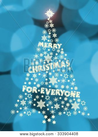Illustration of Christmas tree decal with seasonal greetings on bluish bokeh background