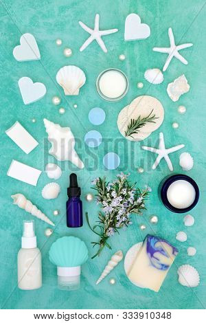 Rosemary herb skin care beauty treatment with cosmetic products. With astringent & anti ageing benefits & helps to reduce environmental skin damage. Flat lay on turquoise.