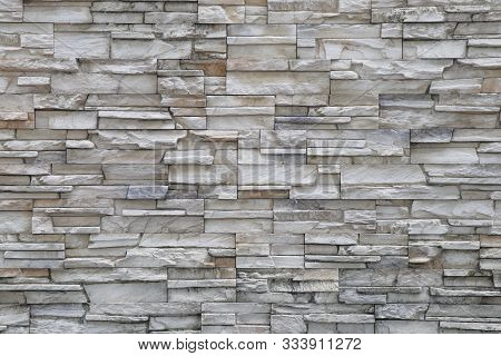 Stone background walls are stacked.  poster