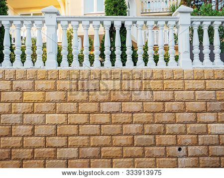 Beautiful Fence With Decorative Stone And White Balusters