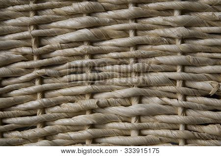Close-up Of A Wicker Basket Woven With Straw In Traditional Craftsmanship