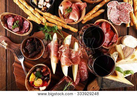 Italian Antipasti Wine Snacks Set. Cheese Variety, Mediterranean Olives, Seafood Salad, Prosciutto D