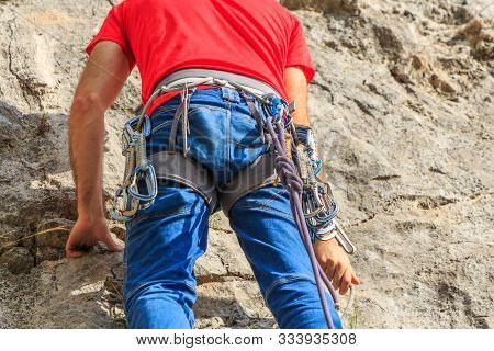 Climber Hanging With Express Tape On His Safety Harness.climbing Concept